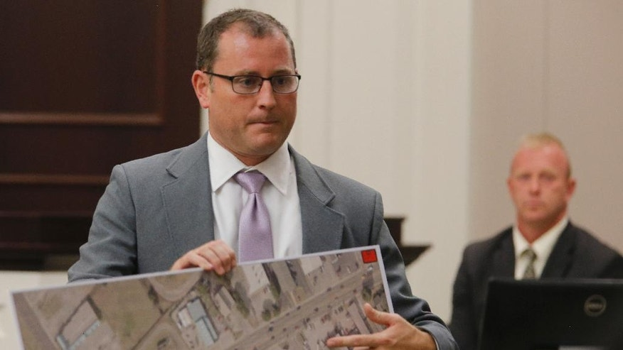 Assistant Solicitor Chad Simpson, left, speaks with North Charleston Police Sgt. Scott Hille as Hille testifies during the trial of former North Charleston Police Officer Michael Slager, Thursday, Nov. 3, 2016 in Charleston, S.C. Slager faces 30 years to life if convicted of murder in the April 2015 death of Scott, whose shooting, captured on a bystander's dramatic cellphone video, spread on social media and stunned the nation. (Grace Beahm/Post and Courier via AP, Pool, File)