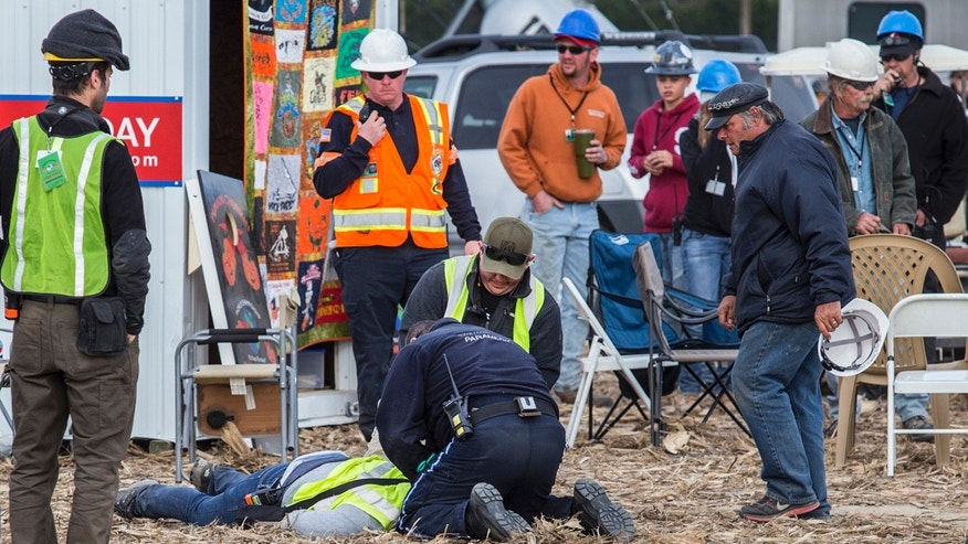 Paramedics tend to a person who was injured after an apparatus used to launch pumpkins into the air exploded at the World Championship Punkin Chunkin Contest in Bridgeville, Del., Sunday, Nov. 6, 2016.