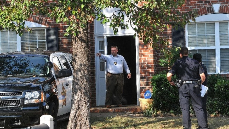 "In this Thursday, Nov. 3, 2016 photo, registered sex offender Todd Christopher Kohlhepp's home is searched by Spartanburg County Sheriff's deputies and his vehicles are impounded in Moore, S.C., after he was arrested earlier in the day. A woman who was ""chained up like a dog"" for weeks in a dark storage container was lured to her captor's South Carolina property for a cleaning job, a family friend said Friday as search teams digging up the area found one body and looked for more. Kohlhepp, 45, who has a previous kidnapping conviction as a teenager in Arizona, appeared at a bond hearing Friday in Spartanburg on a kidnapping charge. More charges will be filed later, the prosecutor told the court.  (John Byrum/The Spartanburg Herald-Journal via AP)"