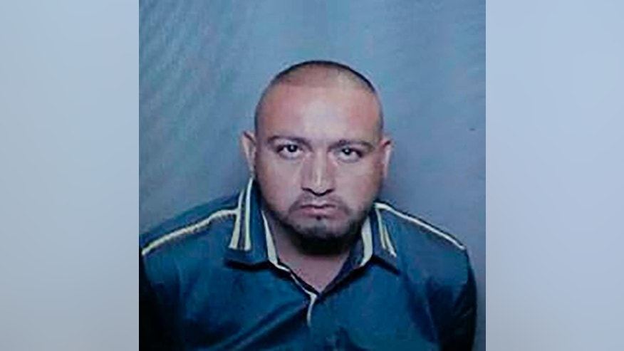 In this undated photo released by La Palma Police Department shows Javier Anguiano, a suspect escaped from officer custody while at La Palma Hospital in La Palma, Calif., early Sunday, Nov. 6, 2016. Police in Southern California are searching for Anguiano, a handcuffed car theft suspect who bolted from a hospital while being treated for injuries in a traffic collision. Police say he had been arrested on suspicion of driving a stolen car and possessing drugs. Police say the 30-year-old had his hands cuffed in front of him, was wearing an unbuttoned plaid short-sleeved shirt, jeans and black loafers. Police say the suspect is unarmed, but should be considered dangerous. (La Palma Police Department via AP)