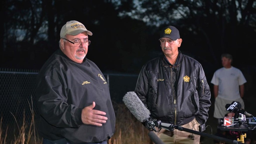 Spartanburg County Coroner Rusty Clevenger, left and Spartanburg County Sheriff Chuck Wright hold a news conference in front of Todd Kohlhepp's property in Woodruff, S.C., Sunday, Nov. 6, 2016. Authorities have found another body buried at the rural South Carolina property where a woman was found chained in a metal container. (AP Photo/Richard Shiro)