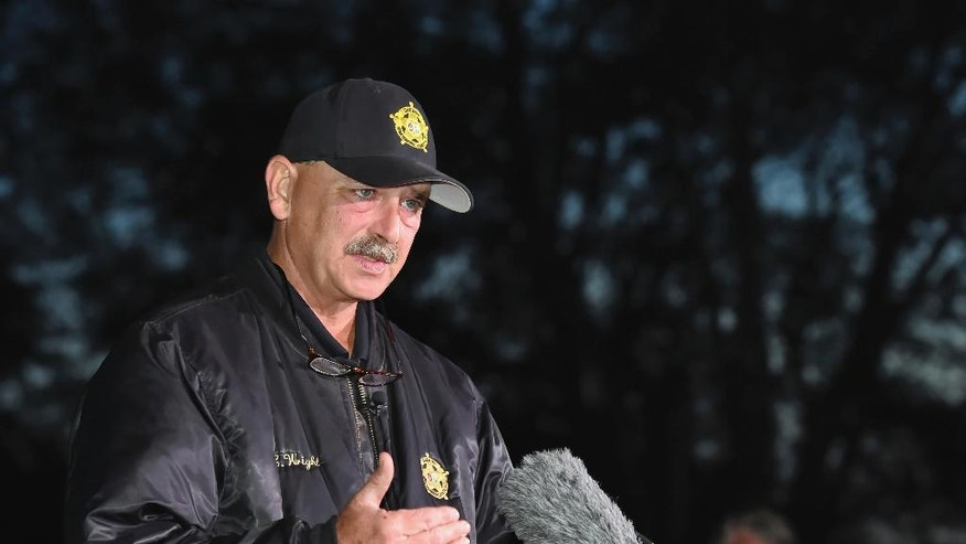 Spartanburg County Sheriff Chuck Wright speaks during a news conference in front of Todd Kohlhepp's property in Woodruff, S.C., Sunday, Nov. 6, 2016. Authorities have found another body buried at the rural South Carolina property where a woman was found chained in a metal container. (AP Photo/Richard Shiro)