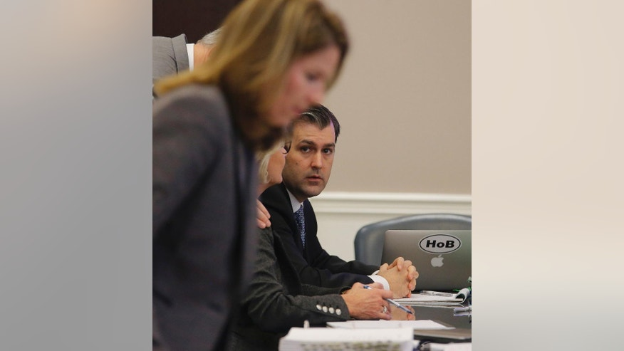 Former North Charleston Police Officer Michael Slager sits at the defense table during testimony in Slager's murder trial, Monday, Nov. 7, 2016, in Charleston, S.C. Slager is on trial facing a murder charge in the shooting death of Walter Scott, who was gunned down after he fled from a traffic stop. (Grace Beahm/Post and Courier via AP, Pool)