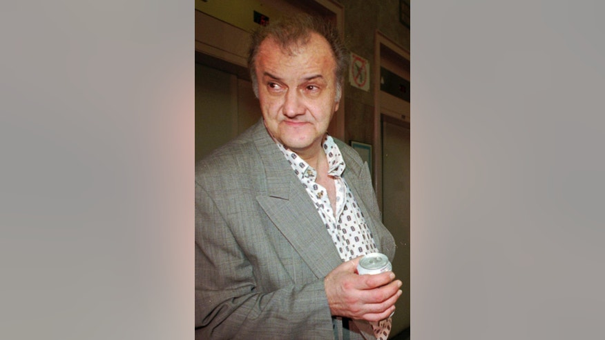"FILE - In this June 17, 1997 file photo, convicted mobster Anthony ""The Saint"" St. Laurent waits to testify in federal court in Boston. St. Laurent, died Monday, Nov.7, 2016 two weeks after being released from federal prison. He was in his 70s and had several health issues. St. Laurent pleaded guilty in 2011 to a plot to have fellow mob member Robert ""Bobby"" DeLuca killed, a plot that was never carried out. (AP Photo/Gretchen Ertl, File)"