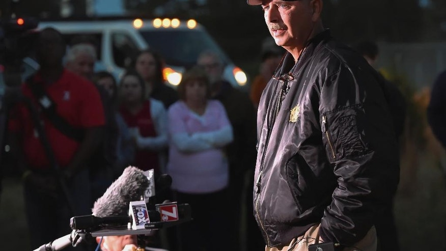 Spartan burg Sheriff Chuck Wright speaks during a news conference in front of Todd Kohlhepp's property in Woodruff, S.C., Sunday, Nov. 6, 2016. Authorities have found another body buried at the rural South Carolina property where a woman was found chained in a metal container. (AP Photo/Richard Shiro)