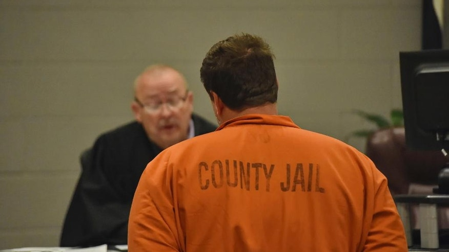 Todd Kohlhepp is addressed by Judge Jimmy Henson during a bond hearing at the Spartanburg Detention Facility, in Spartanburg, S.C. Sunday, Nov. 6, 2016.  The judge denied bond for Kohlhepp, charged with a 2003 quadruple slaying and more recently holding a woman captive on his property.  (AP Photo/Richard Shiro)
