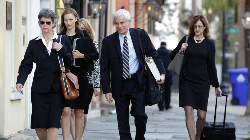 Members of the defense team arrive at the federal courthouse in Charleston, S.C., Monday, Nov. 7, 2016. Jury selection has been postponed in the federal case of Dylann Roof on trial for fatally shooting nine black members at Emanuel AME Church last year. U.S. District Judge Richard Gergel said Monday he had a request from Roof's lawyers that demanded the judge's immediate attention and said jury selection will resume Wednesday. (AP Photo/Chuck Burton)