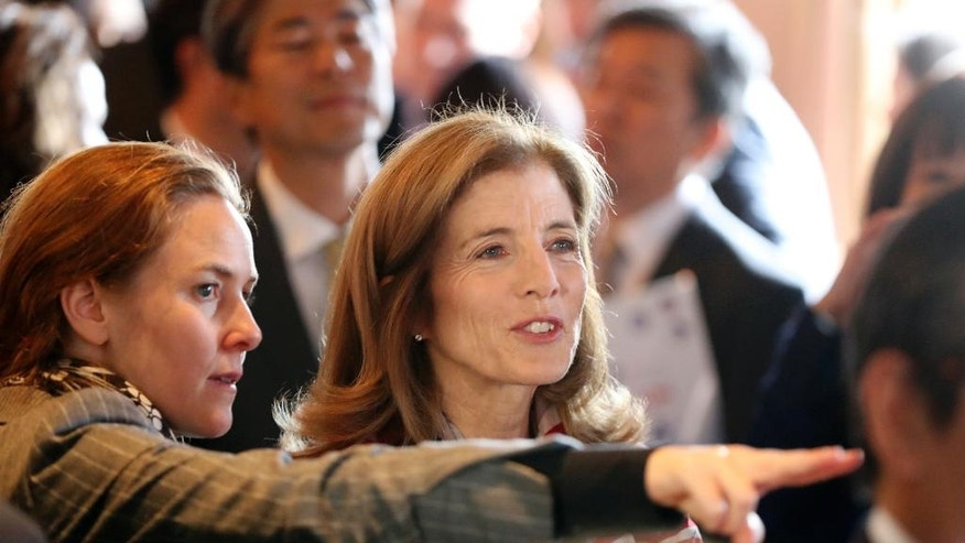 U.S. Ambassador to Japan Caroline Kennedy, center, watches a live broadcasting of the 2016 U.S. Presidential Election results at U.S. Ambassador's residence in Tokyo, Wednesday, Nov. 9, 2016. (AP Photo/Eugene Hoshiko)