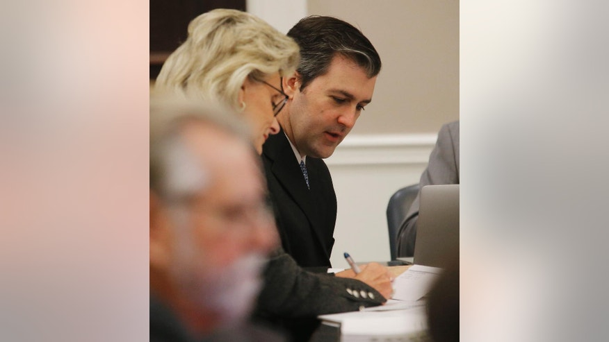 Former North Charleston Police Officer Michael Slager, right, sits at the defense table during testimony in Slager's murder trial, Monday, Nov. 7, 2016, in Charleston, S.C. Slager is on trial facing a murder charge in the shooting death of Walter Scott, who was gunned down after he fled from a traffic stop. (Grace Beahm/Post and Courier via AP, Pool, File)