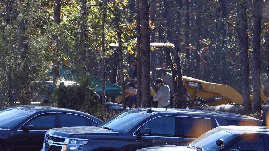Excavation and search work continues on Todd Kohlhepp's property in Woodruff, S.C. Monday, Nov. 7, 2016. Kohlhepp was arrested for kidnapping a woman and keeping her in a storage container on his property. He is also charged with four counts of murder at Superbike Motorsports in Chesnee, S.C. in 2003. (AP Photo/Richard Shiro)