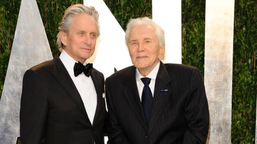 "FILE - In this Feb. 26, 2012 file photo, Michael Douglas, left, and Kirk Douglas arrive at the Vanity Fair Oscar party in West Hollywood, Calif. Kirk Douglas has received an early 100th birthday present — an award from the World Jewish Congress for his strong support for Israel, including starring in the first Hollywood feature film shot in the newly established nation. Oscar-winning actor and producer Michael Douglas accepted the award at a dinner at the Pierre Hotel on Wednesday, Nov. 9, 2016, telling over 400 guests that his father will be ""so proud and so humbled."" (AP Photo/Evan Agostini, File)"