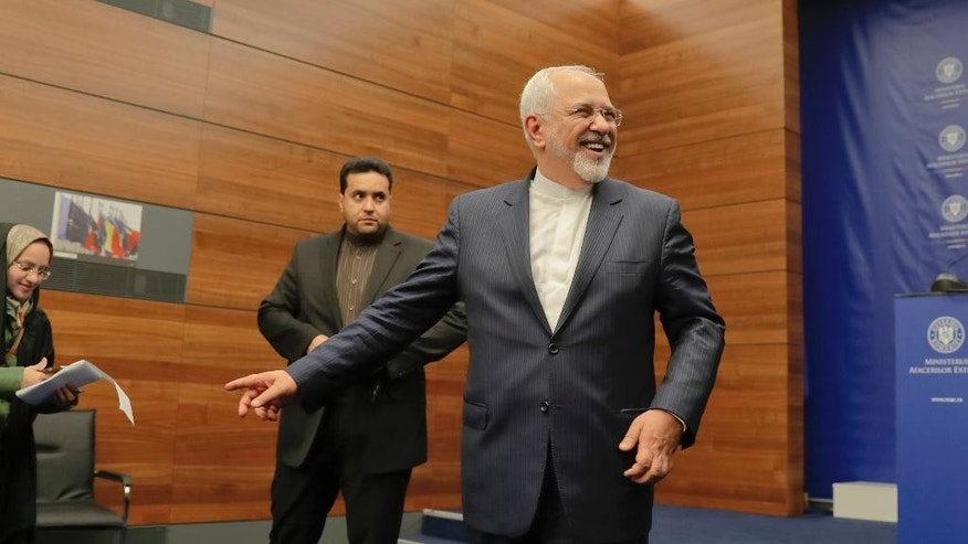 Iran's Foreign Minister Mohammad Shafir leaves after a press conference in Bucharest, Romania, Wednesday, Nov. 9, 2016. Iran's foreign minister, who did not mention President-elect Donald Trump by name or the nuclear deal signed by the Obama administration this year, says that the future U.S. president should respect agreements that have already been signed by Washington. (AP Photo/Vadim Ghirda)