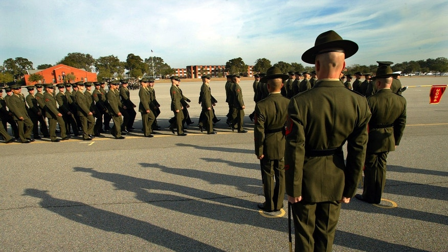 Marine Corps recruits march past their drill instructors at Parris Island.
