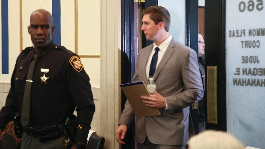 Ray Tensing walks into court on the day of closing arguments in his trial, Wednesday, Nov. 9, 2016, in Cincinnati. The former University of Cincinnati police officer is charged with murdering Sam DuBose while on duty during a routine traffic stop on July 19, 2015. (Cara Owsley/The Cincinnati Enquirer via AP, Pool)