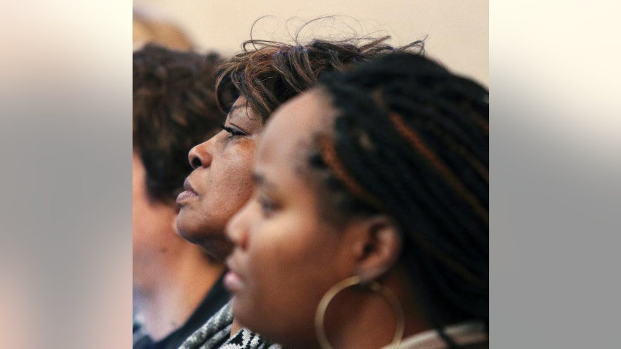 Sam DuBose's mother, Audrey DuBose, listens to the prosecution make its closing arguments in the trial of Ray Tensing, Wednesday, Nov. 9, 2016, in Cincinnati. Tensing, the former University of Cincinnati police officer is charged with murdering Sam DuBose while on duty during a routine traffic stop on July 19, 2015. (Cara Owsley/The Cincinnati Enquirer via AP, Pool)