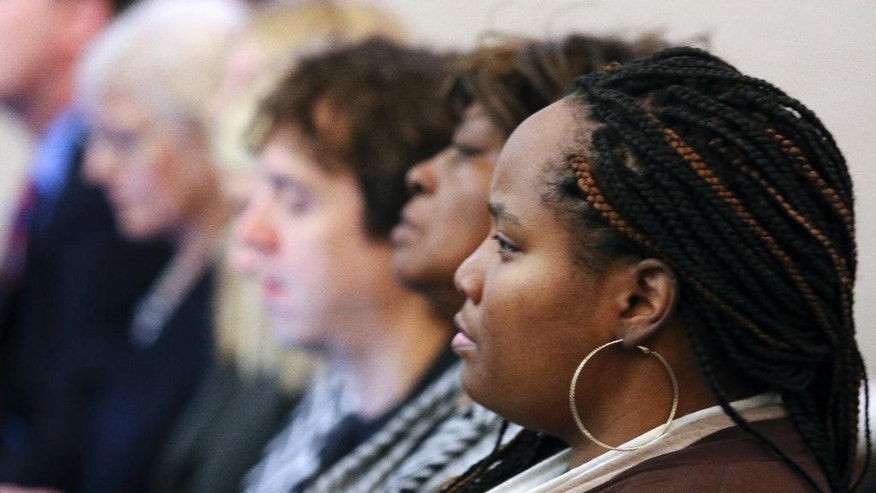 Sam DuBose's sister, Cleshawn DuBose listens to the prosecution make its closing arguments in the trial of Ray Tensing, Wednesday, Nov. 9, 2016, in Cincinnati. Tensing, the former University of Cincinnati police officer is charged with murdering Sam DuBose while on duty during a routine traffic stop on July 19, 2015. (Cara Owsley/The Cincinnati Enquirer via AP, Pool)