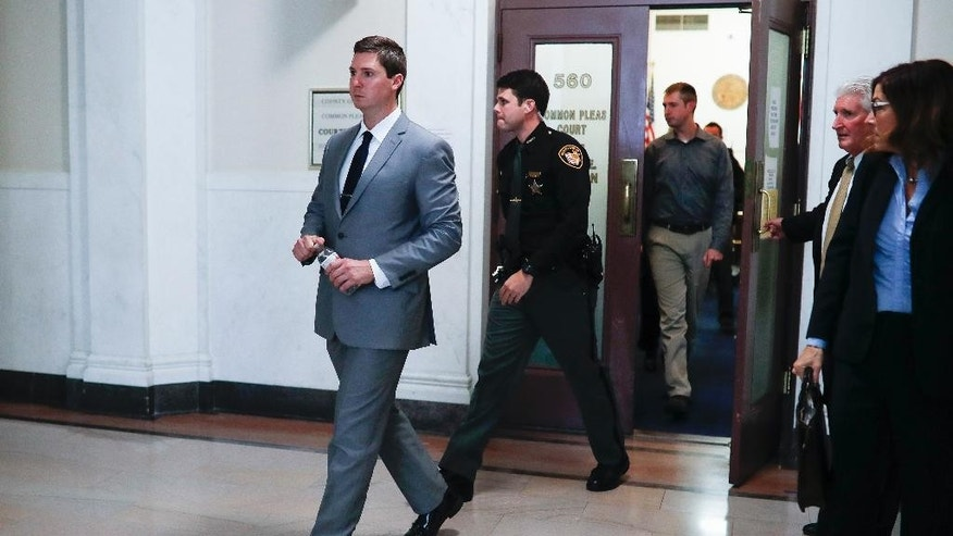 Ray Tensing leaves court on the day of closing arguments in his murder trial, Wednesday, Nov. 9, 2016, in Cincinnati. The former University of Cincinnati police officer is charged with murdering Sam DuBose while on duty during a routine traffic stop on July 19, 2015. (AP Photo/John Minchillo)