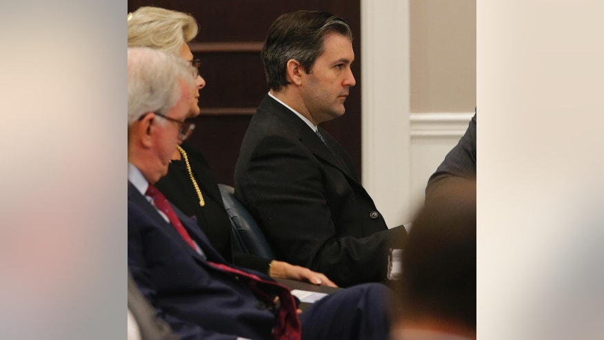 Former North Charleston Police Officer Michael Slager sits at the defense table during testimony in Slager's murder trial, Thursday, Nov. 10, 2016, in Charleston, S.C. Slager is on trial facing a murder charge in the shooting death of Walter Scott, who was gunned down after he fled from a traffic stop. (Grace Beahm/Post and Courier via AP, Pool)