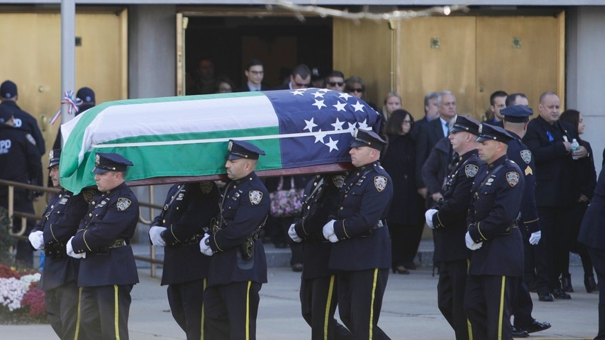 Officers carry the casket of NYPD Sgt. Paul Tuozzolo.
