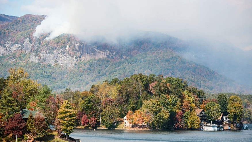 Smoke from the Party Rock fire near Lake Lure spreads as emergency services and the N.C. Forest Service work to contain the blaze Wednesday Nov. 9, 2016 at Lake Lure, N.C.