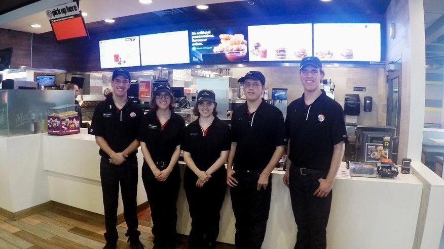 Oct. 6, 2016: Lucas, Lauren, Lindsey, Leith and Logan Curtis, left to right, pose in the lobby of a McDonald's in Potterville, Mich. The 18-year-old non-identical quintuplets all work at the Lansing-area restaurant.