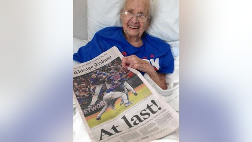This undated photo shows Mabel Ball with a copy of the Chicago Tribune from Nov. 3, 2016, the day after the Chicago Cubs won the World Series