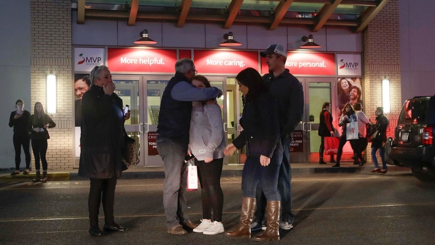 Nov. 12, 2016: People embrace after leaving Crossgates Mall in Guilderland, N.Y., after reports of gunfire inside.