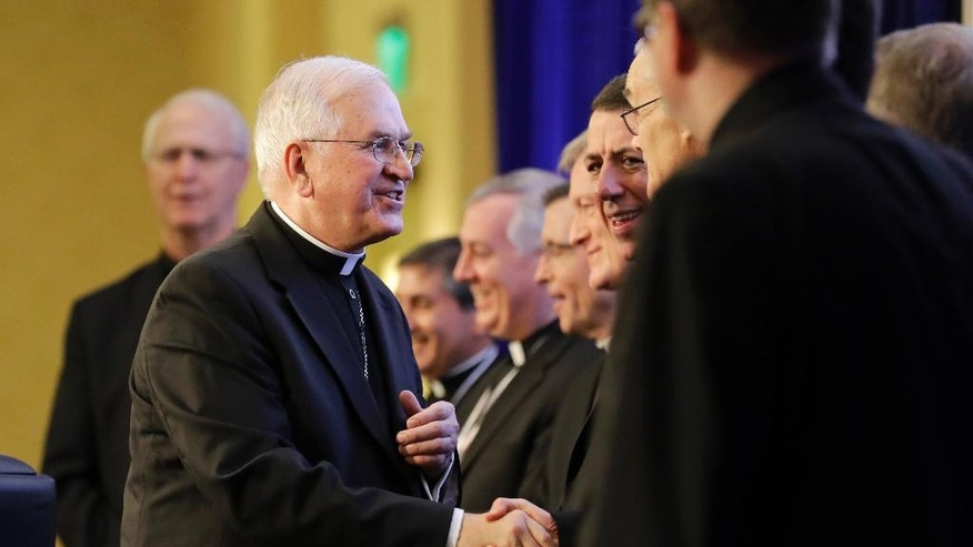 Archbishop Joseph Kurtz, of Louisville, Ky., president of the United States Conference of Catholic Bishops, greets new bishops during the USCCB's annual fall meeting in Baltimore, Monday, Nov. 14, 2016. The bishops opened their meeting by urging President-elect Donald Trump to adopt humane policies toward immigrants and refugees. (AP Photo/Patrick Semansky)