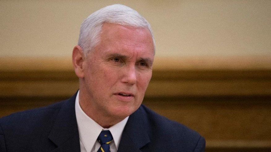 Vice President-elect Mike Pence participates in a cabinet meeting in the governor's Statehouse office in Indianapolis, Monday, Nov. 14, 2016. (AP Photo/Michael Conroy)