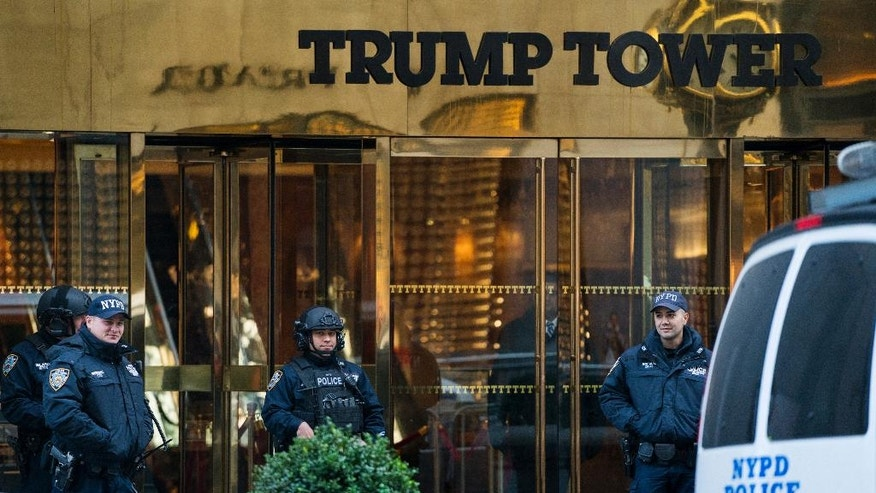 New York City police stand guard in front of Trump Tower, a residence of President-elect Donald Trump in New York, Sunday, Nov. 13, 2016. (AP Photo/Craig Ruttle)