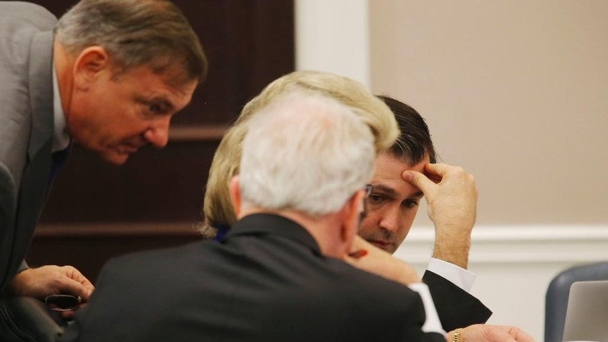 Michael Slager, right, confers with his attorneys, during his trial at the Charleston County court in Charleston, S.C., Monday, Nov. 14, 2016. Slager, a white police officer is accused in the shooting death of an unarmed black motorist. (Grace Beahm/Post and Courier via AP, Pool)