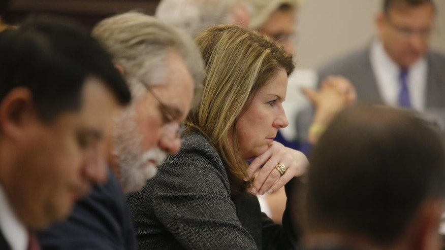 Ninth Circuit Solicitor Scarlett Wilson listens to Judge Clifton Newman in Charleston, S.C., on Monday, Nov. 14, 2016, as the trial of Michael Slager, a white police officer accused in the shooting death of an unarmed black motorist, enters its third week. (Grace Beahm/The Post And Courier via AP, Pool)