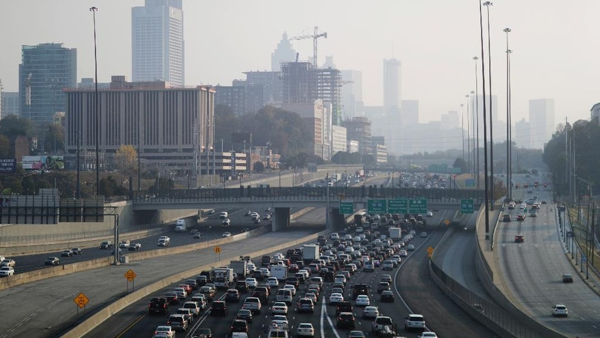 A haze hovers over the downtown skyline from a wildfire burning in the northwest part of the state, Monday, Nov. 14, 2016, in Atlanta. Fires, many of them suspected arsons, have prompted evacuations in Georgia, North Carolina and Tennessee recently. (AP Photo/David Goldman)