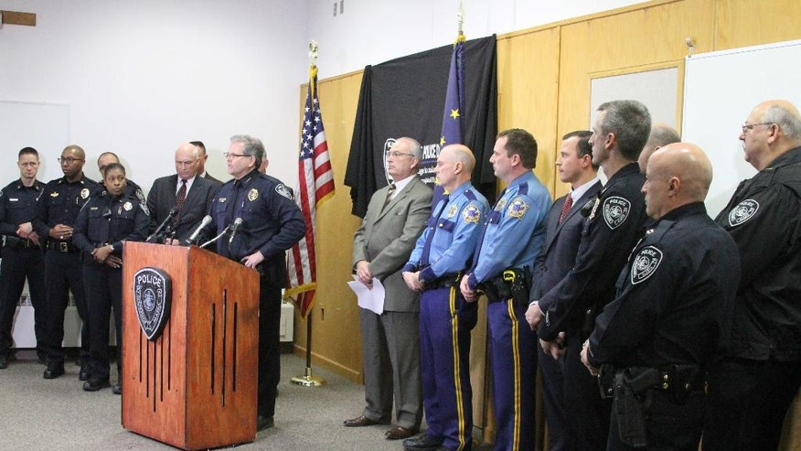 Anchorage Police Chief Chris Tolley, surrounded by Alaska law enforcement officers, speaks at a news conference in Anchorage, Alaska, on Tuesday, Nov. 15, 2016. Tolley said the gun used in the shooting of an officer over the weekend has been linked to five killings in Alaska's biggest city this year.  (AP Photo/Mark Thiessen)