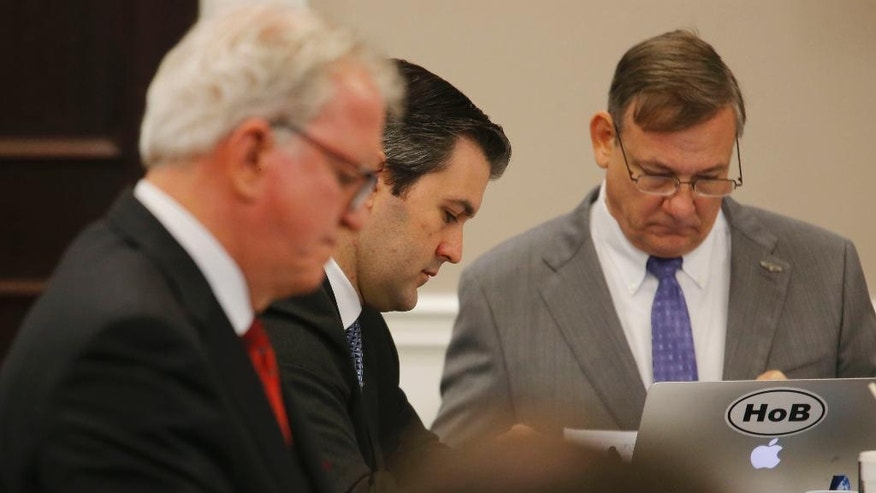 Michael Slager, center, sits with his attorneys during his trial in Charleston County Court in Charleston, S.C., Monday, Nov. 14, 2016. Slager, a white police officer is accused in the shooting death of an unarmed black motorist. (Grace Beahm/Post and Courier via AP, Pool)