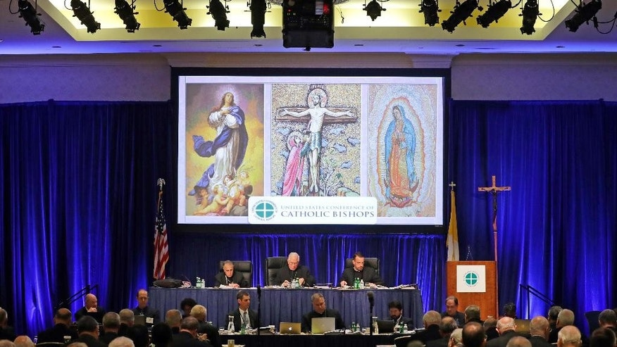 Archbishop Joseph Kurtz, of Louisville, Ky., center, president of the United States Conference of Catholic Bishops, leads the USCCB's annual fall meeting in Baltimore, Tuesday, Nov. 15, 2016. Cardinal Daniel DiNardo of the Archdiocese of Galveston-Houston was elected Tuesday as president of the USCCB. Among his duties will be guiding the bishops' relationship with President-elect Donald Trump. (AP Photo/Patrick Semansky)