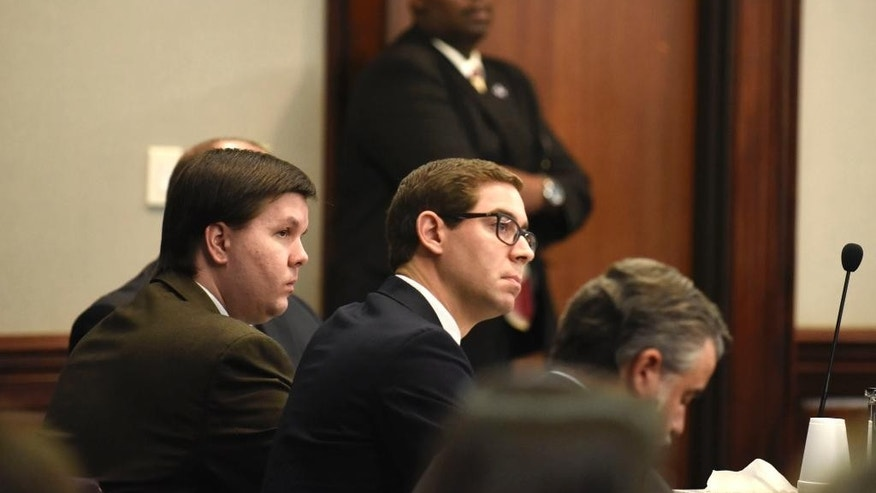 Defense attorney Carlos Rodriguez, center, and defendant Justin Ross Harris look toward a jury as each jury member is polled following the reading of the verdict at the Glynn County Courthouse in Brunswick, Ga., Monday, Nov. 14, 2016. Harris, a Georgia man whose toddler son died after being left for hours in a hot car, was convicted of murder Monday by a jury that concluded a month's worth of trial testimony and evidence showed the father left his child to perish on purpose. (John Carrington/Atlanta Journal-Constitution via AP)