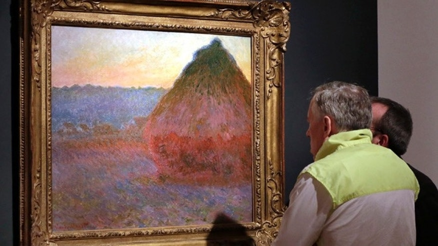 "FILE - In this Nov. 4, 2016, file photo, Claude Monet's ""Grainstack"" is displayed at Christie's, in New York. The 1891 painting being offered Wednesday, Nov. 16, 2016, is one of a few still in private hands. (AP Photo/Richard Drew, File)"