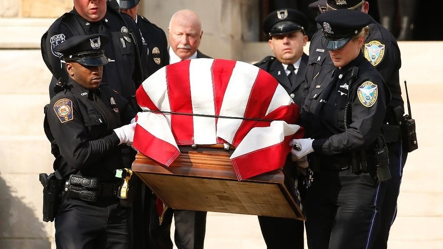 Pallbearers for slain Canonsburg Police officer Scott Bashioum carry the casket down the steps out of the Church of the Covenant following his funeral in Washington, Pa., Wednesday, Nov. 16, 2016. Bashioum was killed and a fellow officer wounded answering a Nov. 10 domestic dispute call. Authorities said 47-year-old Michael Cwiklinski shot both after killing 28-year-old Dalia Sabae. (AP Photo/Jared Wickerham)