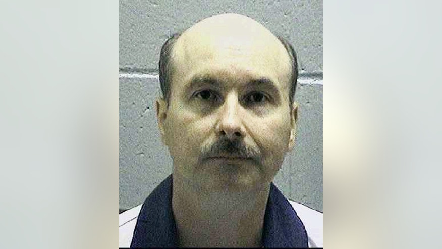 This undated file photo made available by the Georgia Department of Corrections shows William Sallie. A day after carrying out the state's eighth execution this year, authorities in Georgia announced plans for another one. Georgia Attorney General Chris Carr announced Thursday, Nov. 17, 2016, that Sallie is scheduled to die on Dec. 6. Sallie was convicted of murder in the March 1990 slaying of his father-in-law John Lee Moore. (Georgia Department of Corrections via AP)