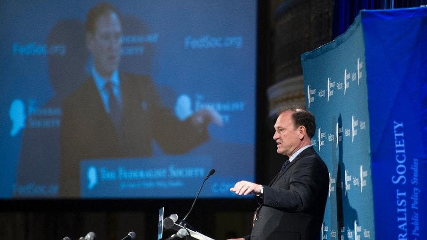 Supreme Court Justice Samuel Alito speaks at the Federalist Society's National Lawyers Convention in Washington, Thursday, Nov. 17, 2016. (AP Photo/Cliff Owen)