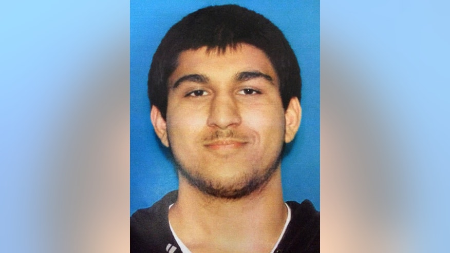 """FILE - This undated Department of Licensing file photo posted Saturday, Sept. 24, 2016, by the Washington State Patrol on its Twitter page shows Arcan Cetin, of Oak Harbor, Wash. The young man accused of fatally shooting five people at the Cascade Mall had a history of violence against animals and his girlfriend, who told police he had links with """"bad people"""" in Turkey, according to documents. (Washington State Patrol via AP, File)"""