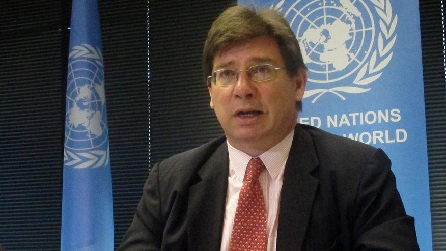 "U.N. Special Rapporteur on the Human Rights of Migrants Francois Crepeau addresses reporters on Friday, Nov. 18, 2016, in Canberra, Australia, at the end of an 18-day fact-finding mission in Australia. Crepeau said a U.S. agreement to resettle an unspecified number of refugees would be a ""great achievement"" if it emptied Australia-run Pacific island camps where asylum seekers were mistreated. (AP Photo/Rod McGuirk)"