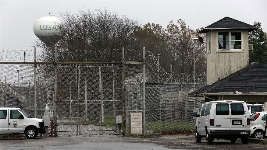 "Security fences surround the Logan Correctional Center Friday, Nov. 18, 2016, in Lincoln, Ill.  Inmates at Illinois' major women's prison have been called ""crazy"" and ""worthless"" by corrections officers, are sometimes placed in an unpadded open-bar ""crisis cage"" and receive harsher discipline than men for similar offenses, a study released Friday says.   (AP Photo/Seth Perlman)"
