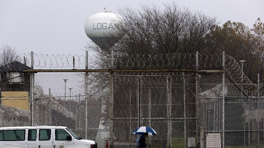"Security fences surround the Logan Correctional Center Friday, Nov. 18, 2016, in Lincoln, Ill. Inmates at Illinois' main prison for women are demeaned as ""crazy"" and ""worthless"" by staff in a facility that offers little help to prepare women to re-enter the community, a study to be released Friday found. The federally funded review of ""gender responsiveness"" concludes women inmates in Illinois are disciplined more often and more harshly than men. (AP Photo/Seth Perlman)"