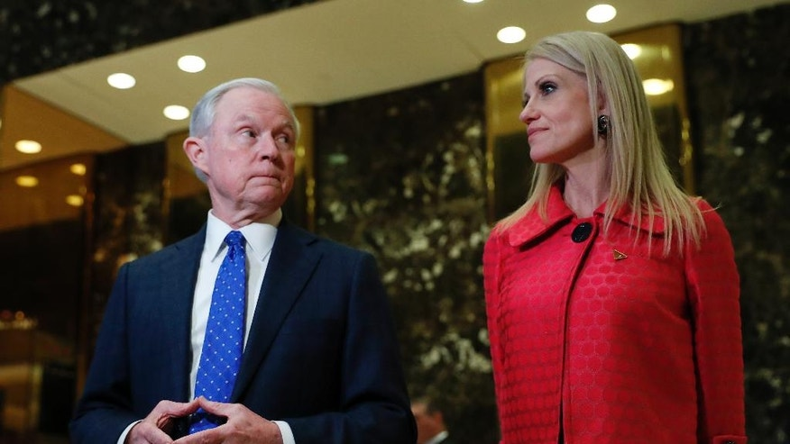 Sen. Jeff Sessions, R-Ala. and Kellyanne Conway, campaign manager for President-elect Donald Trump, speaks to reporters at Trump Tower in New York, Thursday, Nov. 17, 2016. (AP Photo/Carolyn Kaster)