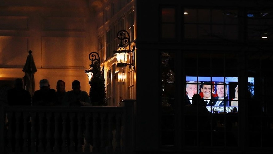 Images of Sen. Jeff Sessions, R-Ala., Retired Lt. Gen. Michael Flynn and Rep. Mike Pompeo, R-Kan., seen on a television screen inside the clubhouse before President-elect Donald Trump arrives at Trump National Golf Club Bedminster in Bedminster Township, N.J., Friday, Nov. 18, 2016. (AP Photo/Carolyn Kaster)