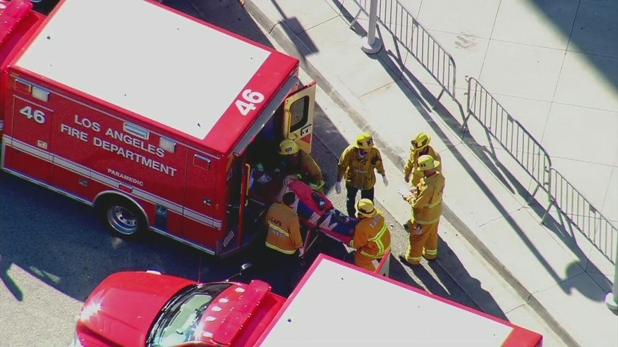 Nov. 21, 2016: Paramedics load an injured person into an ambulance after an accident in downtown Los Angeles