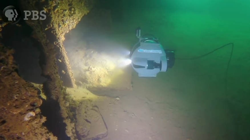 """In an image taken from PBS' """"Pearl Harbor: Into the Arizona"""" film, a remote controlled underwater vehicle explores the lower decks of the sunken U.S.S. Arizona, where 1,177 sailors and Marines died during the Pearl Harbor attack."""