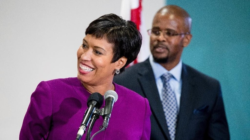 Washington Mayor Muriel Bowser, left, announces Antwan Wilson, right, as the new Washington Schools Chancellor during a news conference at Easter High School in Washington, Tuesday, Nov. 22, 2016. (AP Photo/Andrew Harnik)